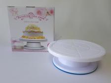 Стойка пластмассовая для торта вращающаяся 27,5 см. х 9 см.